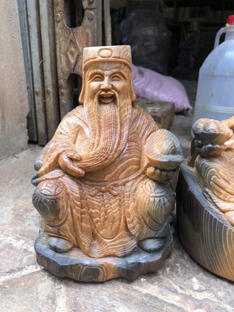 tượng thần tài gỗ thủy tùng đỏ